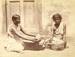 Women with curry stone and raggy mill, Madras